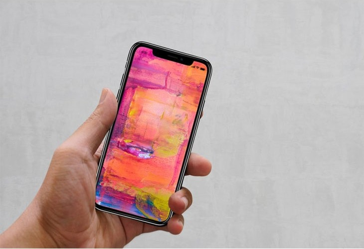 Male Hand holding iPhone XS Mockup
