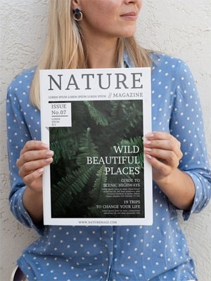 Woman holding with both hands a nature magazine