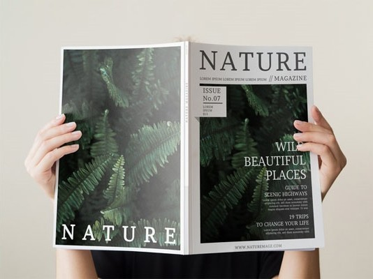 Womans hand holding a nature magazine mock up